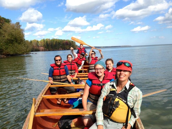 "Professor Elizabeth Andre, Dash, and fellow ""Fall Block"" OED students paddling Lake Superior in the 36' Montreal canoe"