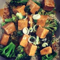 Image of a vegetable dish with cooked broccoli, carrots, and green onions.